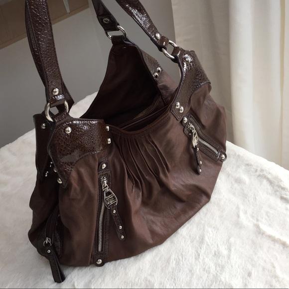 7424daed5 Kathy Van Zeeland Handbags - Kathy Van Zeeland Brown Multi Pocket Shoulder  Bag